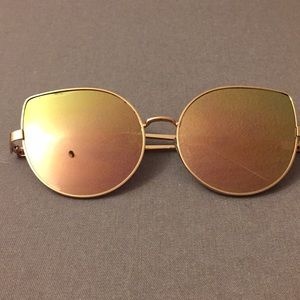 Rose gold reflective sun glasses